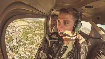 Couple flying Plane