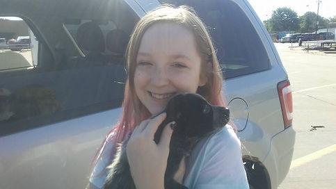 Little girl holding her new Australian Cattle Dog puppy