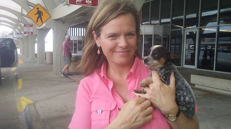 Lady holding her new Miniature Australian Cattle Dog puppy