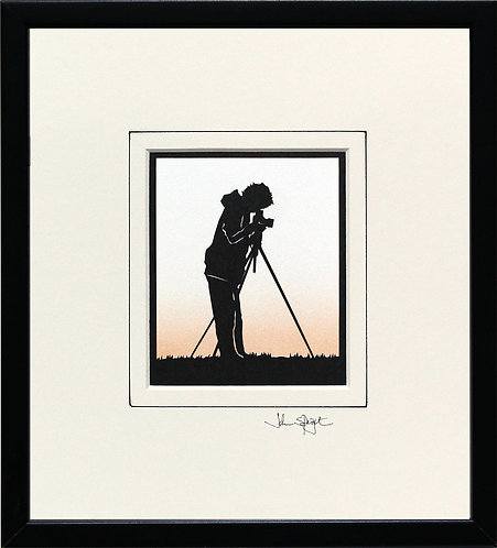 Photographer in Black Frame