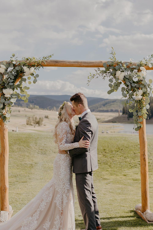 Keystone Wedding - Keystone Ranch Wedding - First Kiss