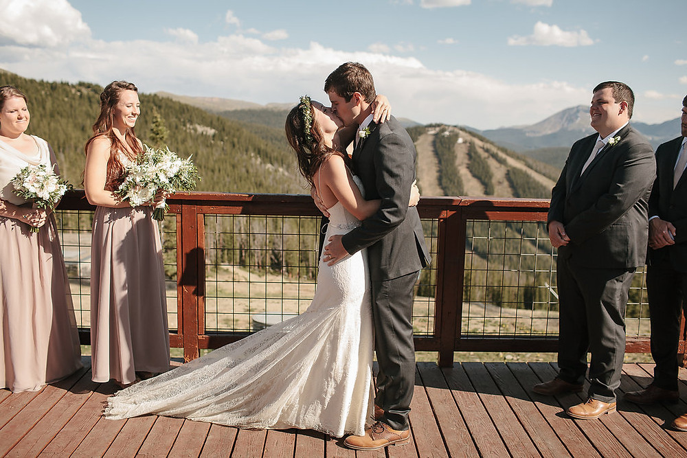 Colorado Wedding Planner - Colorado Wedding couple's first kiss