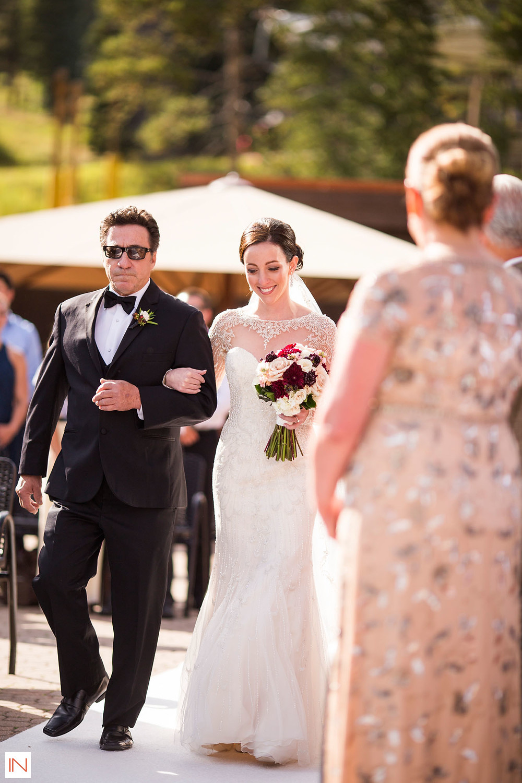 Breckenridge Wedding Planner - Bride walking with her father