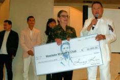 Helene Ross, Founding member, receiving the donation from Mr. Kieu Hoang
