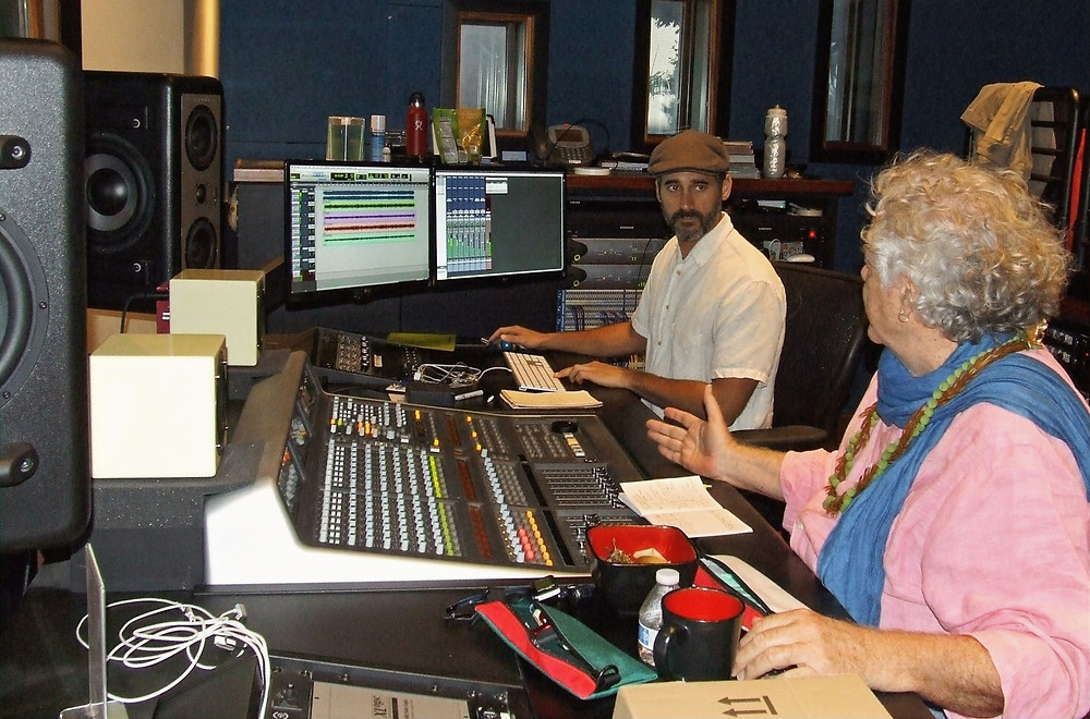 An audio engineer and musicians discussing the recording process.