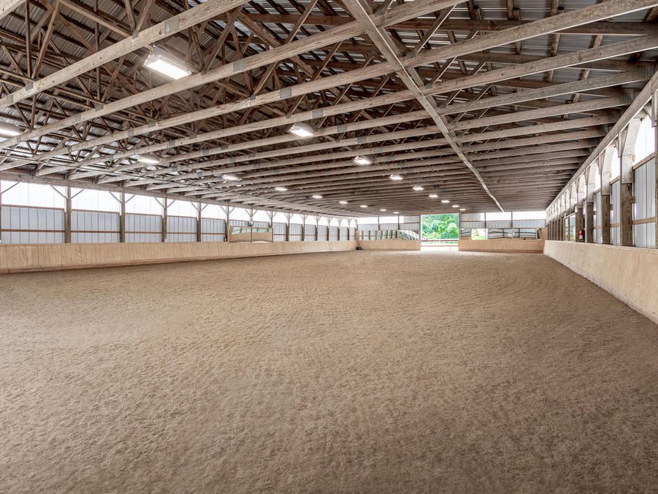 Our newly-renovated indoor arena offers space to ride in inclement weather and all through the winter months.