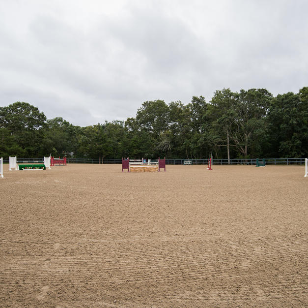 Massive and secluded outdoor jump arena with full course located in the back of the farm is watered and dragged daily to maintain optimal exercising conditions.