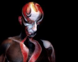 Man bodypaint fire and bones