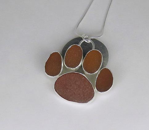 543. Amber Sea Glass Dog Paw Print Pendant