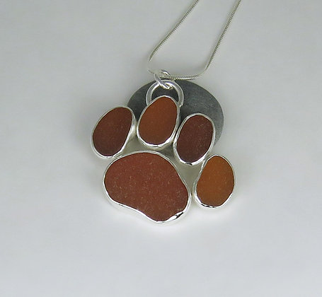 545. Amber Sea Glass Dog Paw Print Pendant