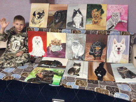 10-летний Павел Абрамов рисует кошек и собак и помогает животным