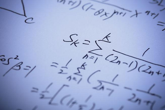Closeup shot of complex math formulas on
