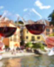 Two wineglasses in the hands. Varenna to