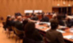 people seated around a conference table