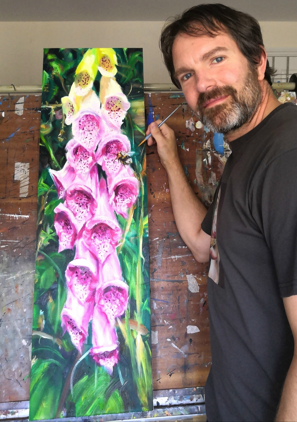 Artist Nick Pike painting bee in foxgloves