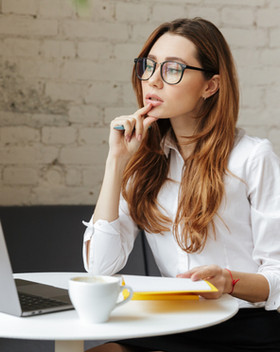 Woman Entrepreneur Thinking About Ordering a Custom Website
