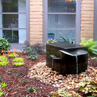 A solid copper fountain in front courtyard.