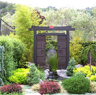 A Chinese water feature designed around two antique doors the owner had previously acquired.