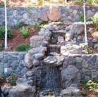 A pondless waterfall with bubbling water source at the top.