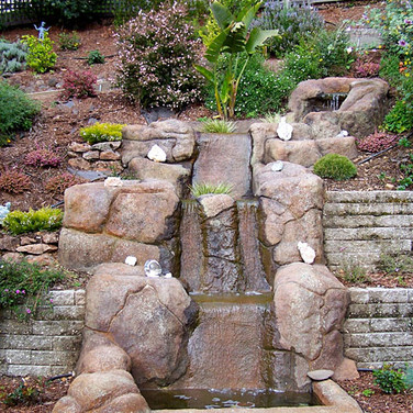 Faux rock waterfall inspired by Sedona, Arizona.