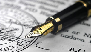 Image of a fountain pen laying on a signed document