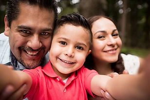 Image of an Hispanic couple and young son