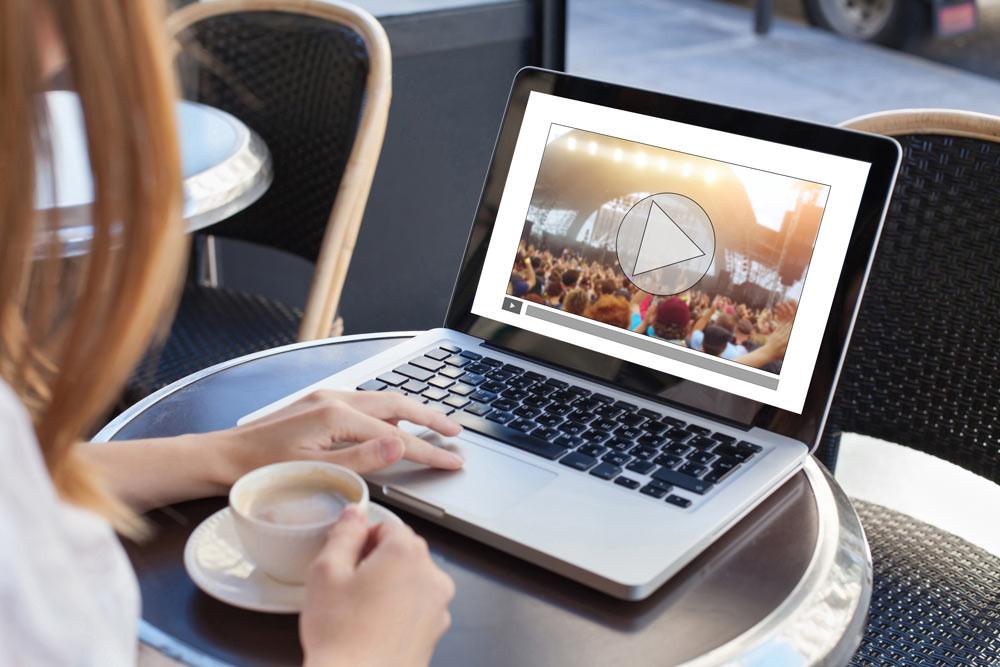 Woman logging onto virtual event