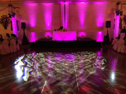 Pink uplights and sweetheart table