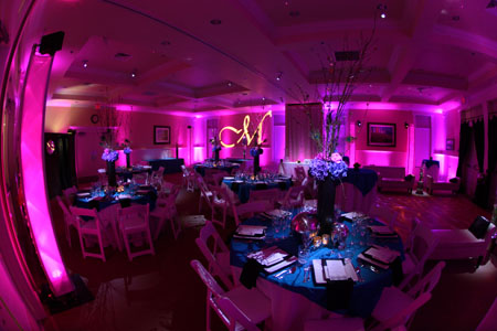 Pink uplighting with monogram gobo
