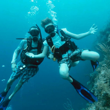 Couple Scuba Diving from Placencia