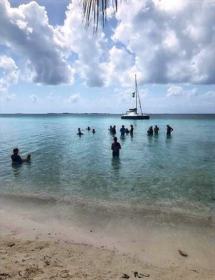 people swimming from island Placencia