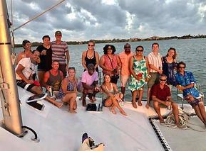 Bluewater Sailing Charter guests posing on boat