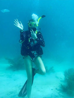 diver waving under water in Placencia Belize