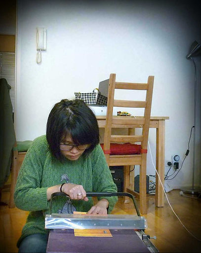 Folding greeting card at her home studio