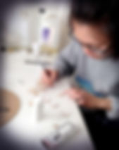 Making brooches and earrings at her home studio