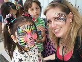 Rainbow tiger face paint by Anna Adair