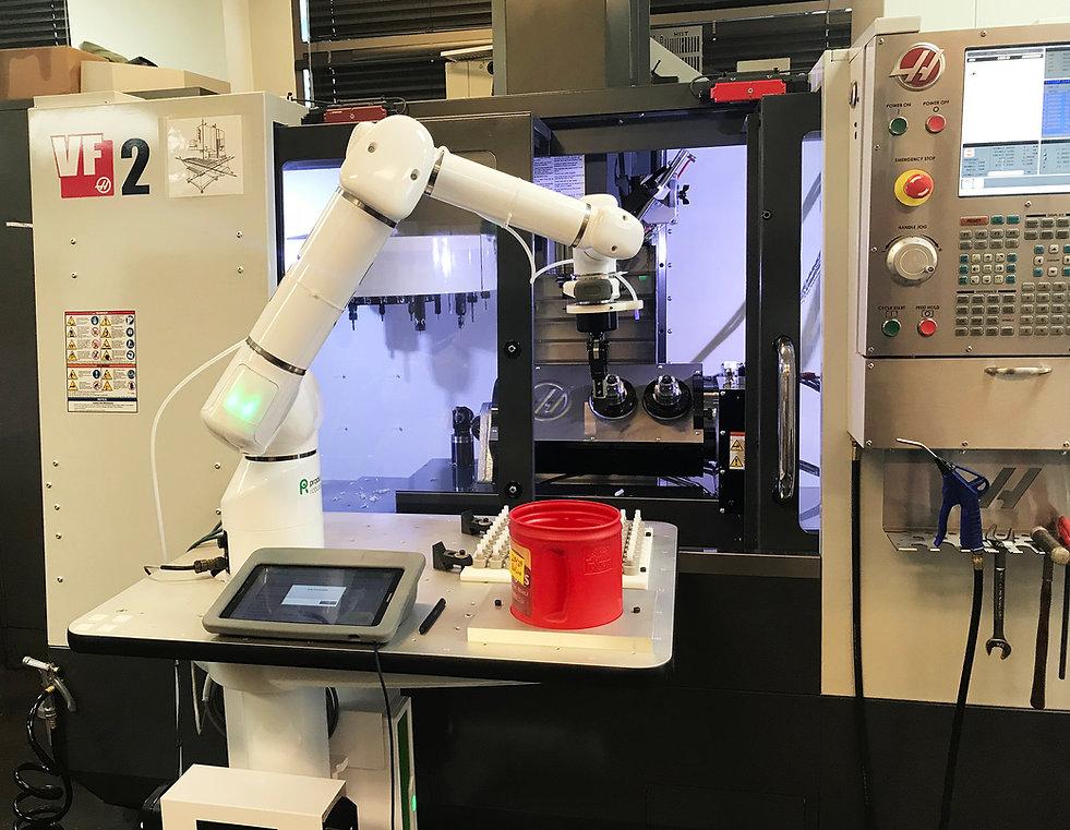 OB7 Cobot loads CNC Machine.jpg