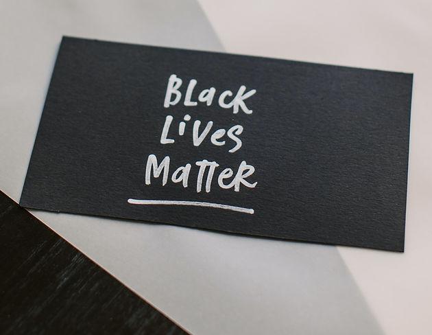 black-lives-matter-written-on-black-pape