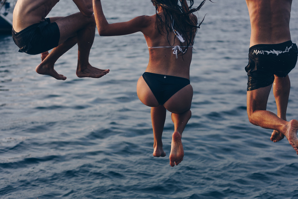 Jumping in the ocean | FTLO Travel | Travel for Young Professionals