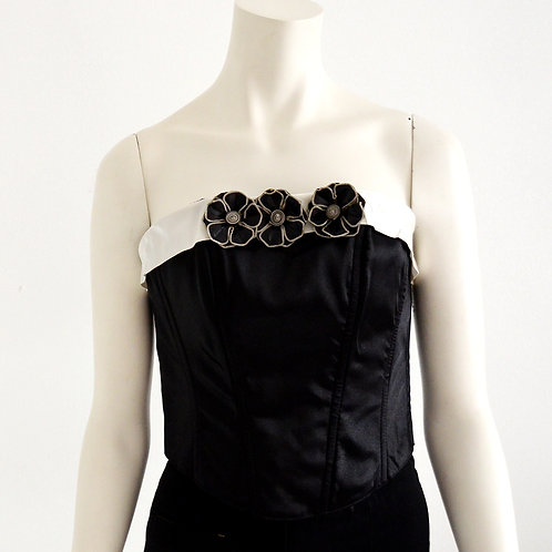 Black and white corset with leather flowers