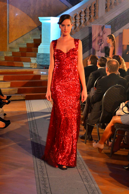 Red dress made of knitted with richly sewn sequins