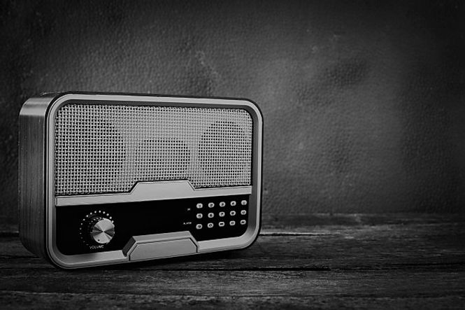 old-retro-radio-with-table-front-gray-ba