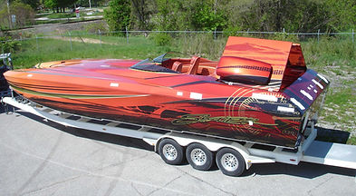 Dean Loucks paints powerboats
