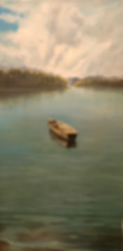 Dean Loucks paints canoe for Troy University