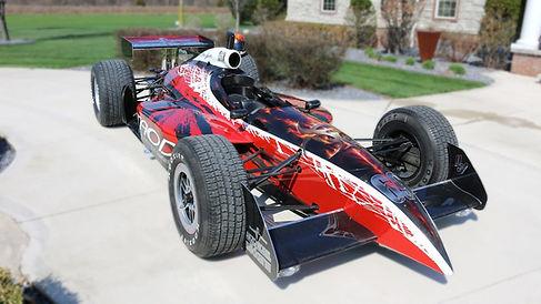 Dean Loucks and Taod paints an Indy car
