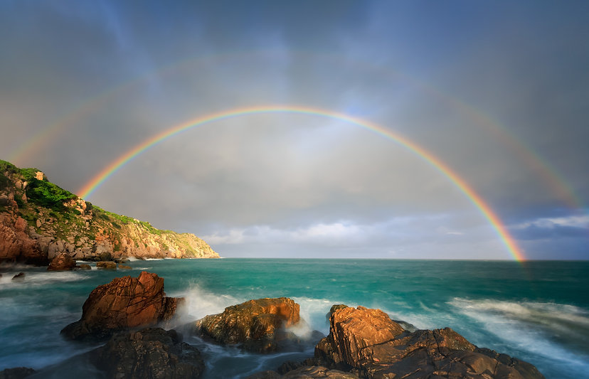Canva - Rainbow over the Sea.jpg