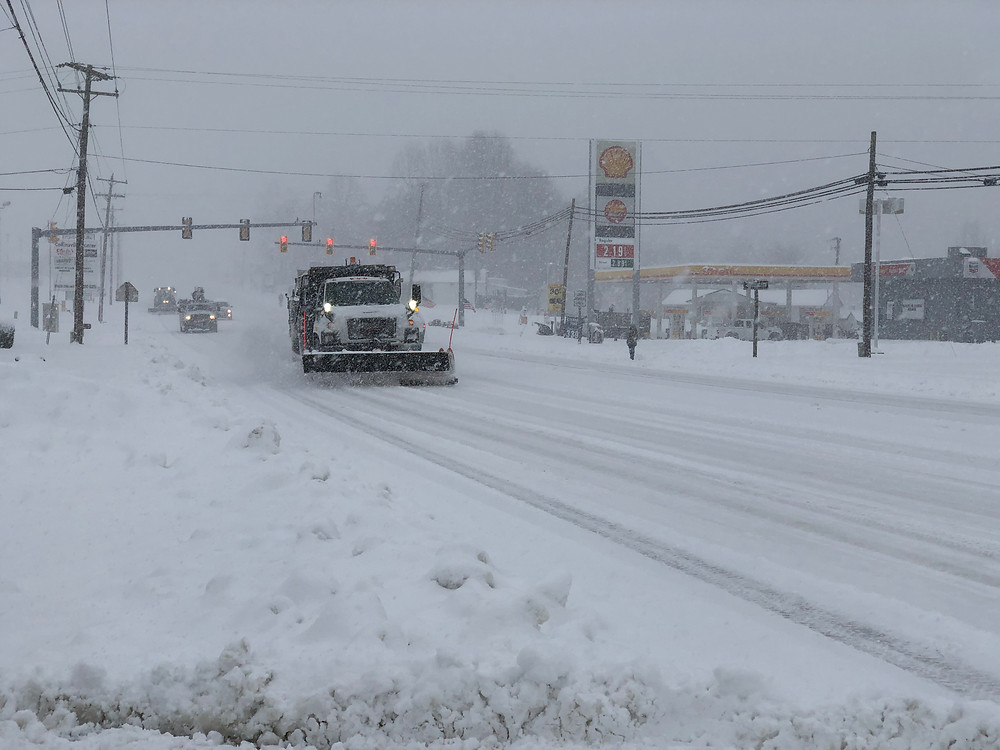 A VDOT vehicle plowing snow in Collinsville during winter storm on December 9, 2018.