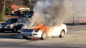 Car goes up in flames in parking lot of Aaron's