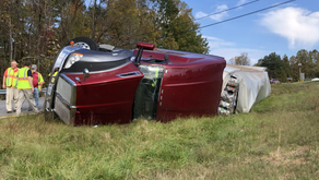 Driver charged after tractor-trailer overturns on Route 220 in Henry County