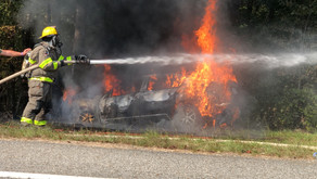 Woman injured after car crashes, catches fire in Henry County